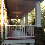 Porch with Mahogany Decking Trimed in Azeck