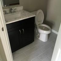 New tile floor, vanity, fixtures and toilet